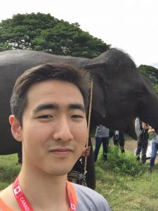Picture of Philip Sohn with an elephant