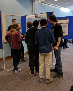 Graduate students present poster describing our research to prospective students.