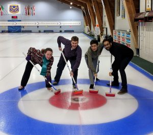 Aggressive sweepers on a curling rink
