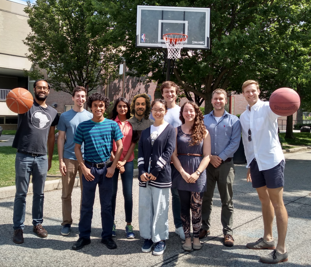 Wilsonlab group members posing in a basketball court (with a photoshopped Phil), summer 2019